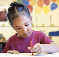 Girl coloring at a desk